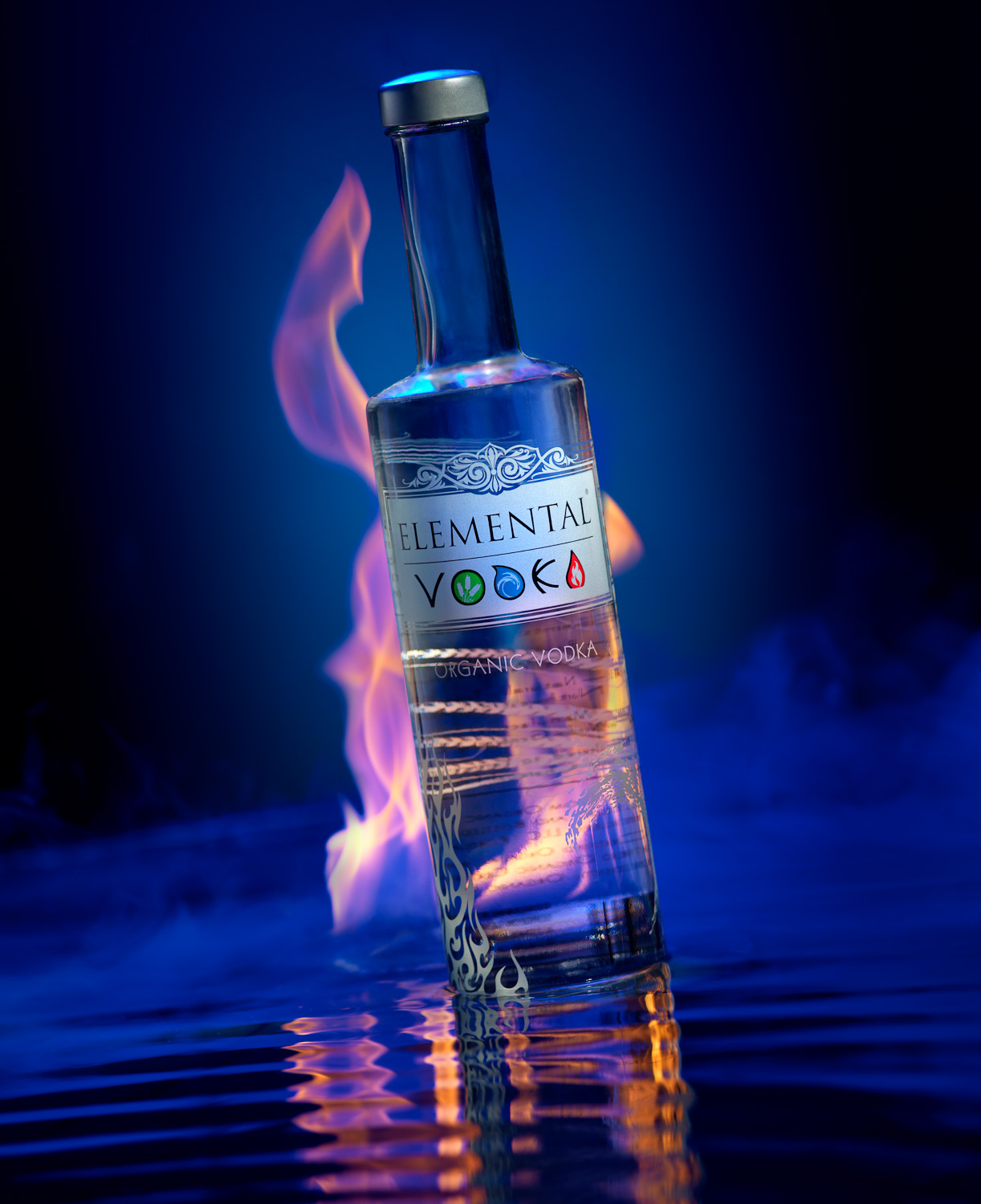 A bottle of Elemental Vodka with flames, smoke, and water